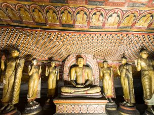 Amazing view of lot Buddhas statues and religious carving inside cave in sacred Golden Temple. Dambulla, Sri Lanka travel destinations
