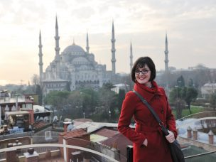 happy young tourist woman travel visit ancient istambul in turkey and old ayasofya blue mosque