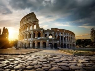 Bright sunset over Colosseum in Rome, Italy