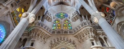 The sun shines through the stained glass windows of Gaudi's masterpiece: La Sagrada Familia