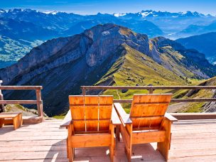 Relax deck chair Swiss Alps panorama,  Pilatus mountain tourist destination, landscape of Switzerland